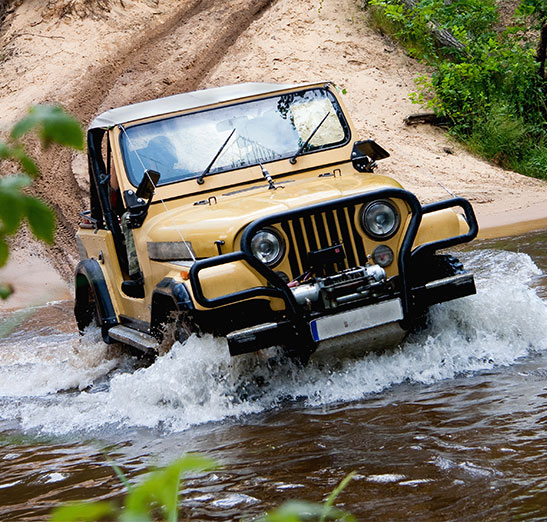 jeep crossing water - we insure jeeps, call Odiorne Insurance today for all of your recreational vehicle or transportation vehicles insurance needs today.