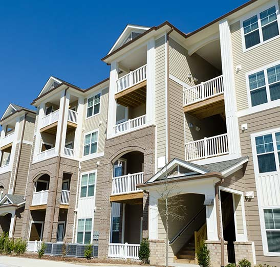 apartment insurance - modern apartment complex with four floors. Call today for apartment complex insurance protection. .