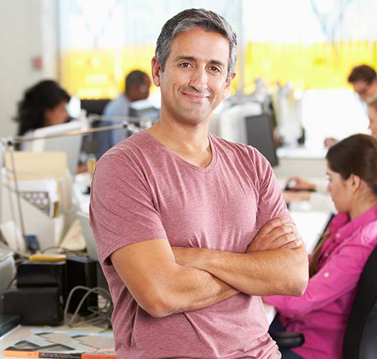 Happy business owner in modern office