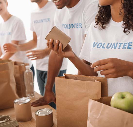 Volunteers packing food bags.