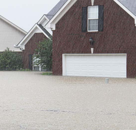 Exterior housing shown with street flooded.