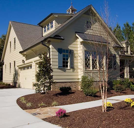 Nice modern home with circular drive and 3 car garage.