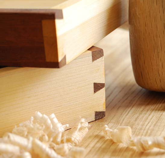 Crafting wood joints showing beautiful dovetail joints