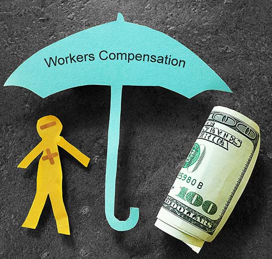 Workers Compensation graphic. Paper cut out person, paper cut out umbrella and a roll of $100 bills